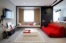 М'які меблі червоного кольору у вітальні